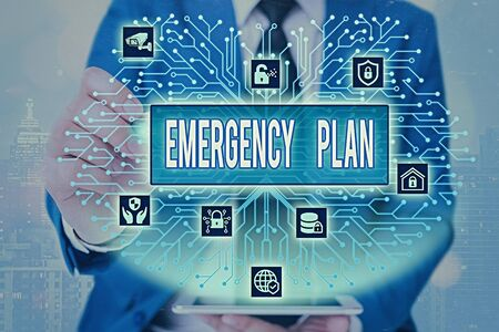 Word writing text Emergency Plan. Business photo showcasing instructions that outlines what workers should do in danger Foto de archivo