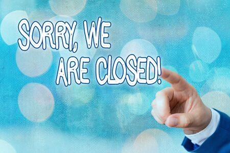 Writing note showing Sorry, We Are Closed. Business concept for apologize for shutting off business for specific time
