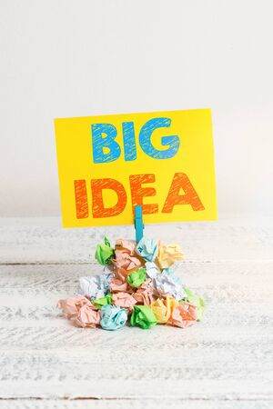 Handwriting text Big Idea. Conceptual photo Having great creative innovation solution or way of thinking Reminder pile colored crumpled paper clothespin reminder white wooden space Stockfoto