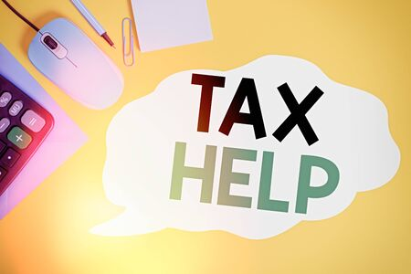 Writing note showing Tax Help. Business concept for Assistance from the compulsory contribution to the state revenue Closed envelope clip mouse calculator pencil note colored background