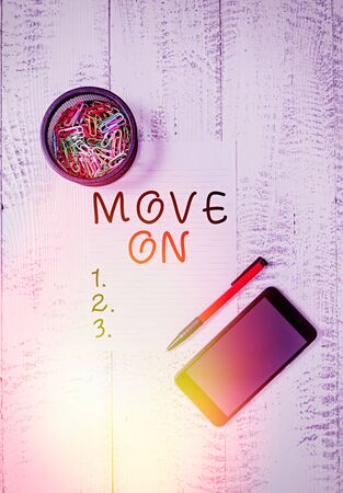 Text sign showing Move On. Business photo text to leave the place where you are staying and go somewhere else Smartphone paper sheet clips holder ballpoint wooden vintage background