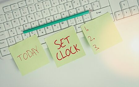 Text sign showing Set Clock. Business photo showcasing put it to the right time or change the clock time to a later time Three empty green square papers and pencil by the pc keyboard with copy space