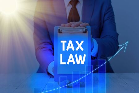 Handwriting text Tax Law. Conceptual photo governmental assessment upon property value or transactions
