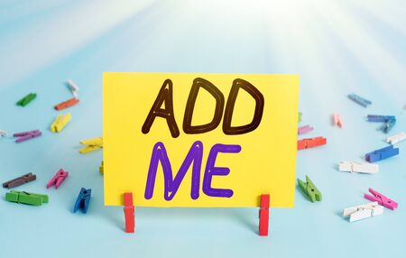 Conceptual hand writing showing Add Me. Concept meaning asking someone to add oneself on there group of friends or followers Colored clothespin rectangle shaped paper blue background