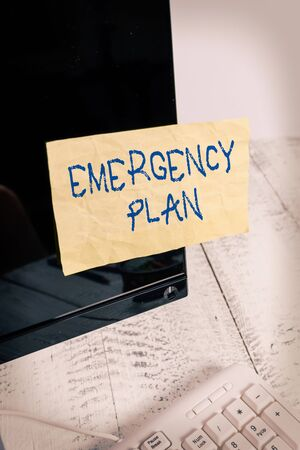 Writing note showing Emergency Plan. Business concept for instructions that outlines what workers should do in danger Notation paper computer monitor screen near white keyboard