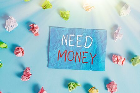 Writing note showing Need Money. Business concept for require a financial assistance to sustain spending or endeavor Colored crumpled rectangle shaped reminder paper light blue background