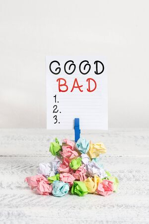 Conceptual hand writing showing Good Bad. Concept meaning to seem to be going to have a good or bad result Life choices Reminder pile colored crumpled paper clothespin wooden space