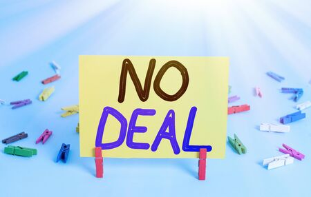 Conceptual hand writing showing No Deal. Concept meaning a negative result on agreement or an arrangement like in business Colored clothespin rectangle shaped paper blue background