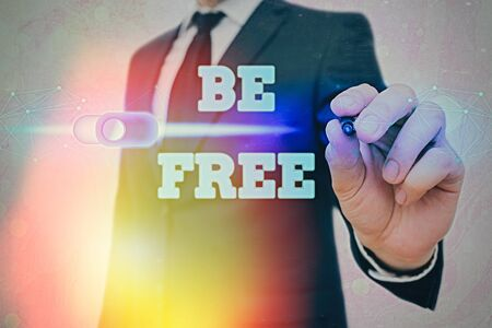Writing note showing Be Free. Business concept for ability to do whatever you want without limitations or controls