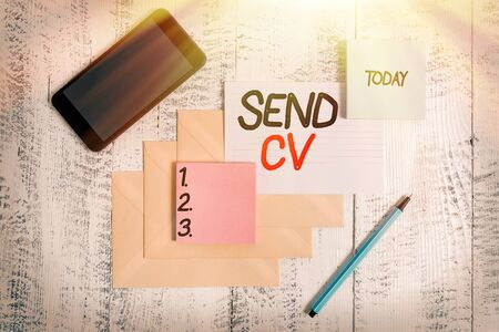 Word writing text Send Cv. Business photo showcasing pass resume to identify the skills or talents specific to the job Envelopes marker ruled paper smartphone sheet note pads wooden background