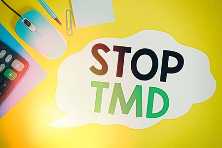 Writing note showing Stop Tmd. Business concept for Prevent the disorder or problem affecting the chewing muscles Closed envelope clip mouse calculator pencil note colored background