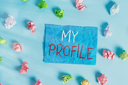 Writing note showing My Profile. Business concept for record of your demonstratingal information that defines who you are Colored crumpled rectangle shaped reminder paper light blue background Stock Photo