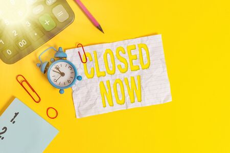Text sign showing Closed Now. Business photo text of a business having ceased trading especially for a short period Alarm clock clips note rubber band calculator pencil colored background