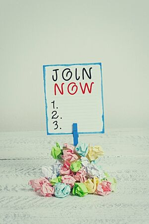 Handwriting text Join Now. Conceptual photo An invite to a demonstrating or a friend to become a member of the group Reminder pile colored crumpled paper clothespin reminder white wooden space