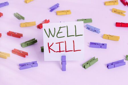 Text sign showing Well Kill. Business photo showcasing operation of placing a column of heavy fluid into a well bore Colored clothespin papers empty reminder white floor background office Archivio Fotografico - 144929978