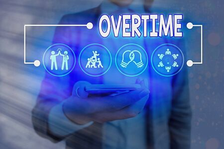 Conceptual hand writing showing Overtime. Concept meaning Time or hours worked in addition to regular working hours