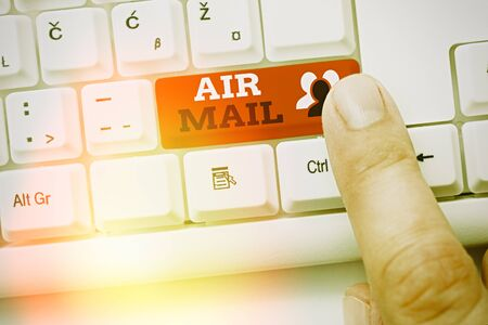 Writing note showing Air Mail. Business concept for the bags of letters and packages that are transported by aircraft Standard-Bild