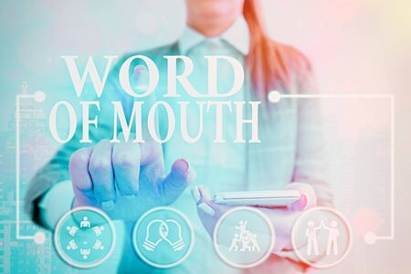 Writing note showing Word Of Mouth. Business concept for information that is transmitted without being written down Banque d'images