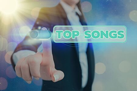 Conceptual hand writing showing Top Songs. Concept meaning recorded song that becomes broadly popular or wellknown