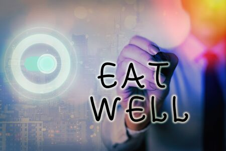 Writing note showing Eat Well. Business concept for Practice of eating only foods that are whole and not processed