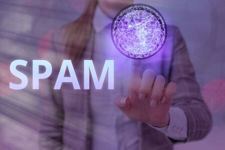 Writing note showing Spam. Business concept for Intrusive advertising Inappropriate messages sent on the Internet