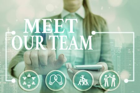 Writing note showing Meet Our Team. Business concept for introducing another demonstrating to your team mates in the company