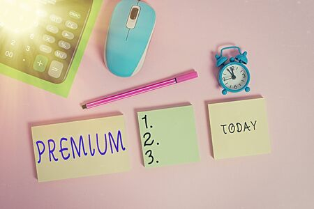 Text sign showing Premium. Business photo text something or someone of greater or superior quality A reward Notepads mouse alarm clock calculator sheet marker colored background