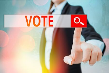 Writing note showing Vote. Business concept for Act of expressing a formal indication of choice Majority wins Banque d'images