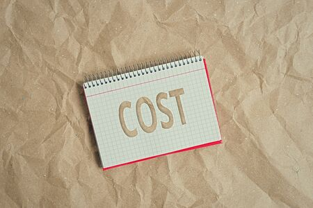 Conceptual hand writing showing Cost. Concept meaning The amount that usualy paid for a item you buy or hiring a demonstrating Papercraft desk square spiral notebook office study supplies Standard-Bild
