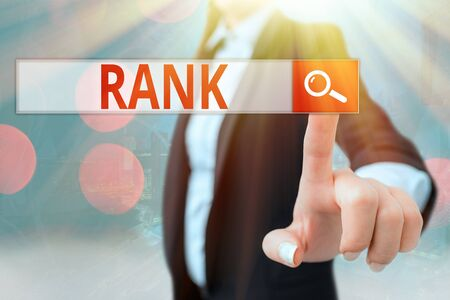 Writing note showing Rank. Business concept for The showing or things that belong to a particular organization or group Standard-Bild