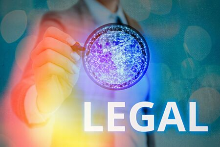 Writing note showing Legal. Business concept for Allowable or enforceable by being in conformity with the law Banco de Imagens