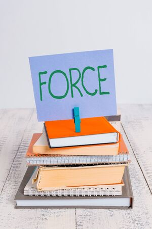 Text sign showing Force. Business photo showcasing strength or energy as an attribute of physical action or movement pile stacked books notebook pin clothespin colored reminder white wooden