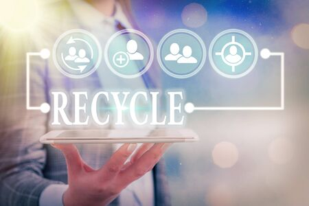 Text sign showing Recycle. Business photo text ocess of converting waste materials into new materials and objects Фото со стока