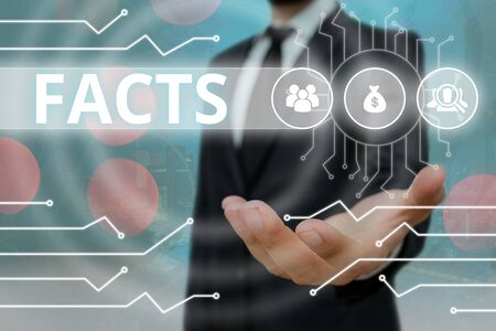 Conceptual hand writing showing Facts. Concept meaning information used as evidence or part of report news article blog Stock Photo