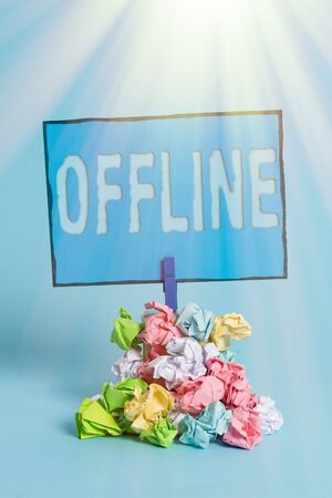 Writing note showing Offline. Business concept for Not having directly connected to a computer or external network Reminder pile colored crumpled paper clothespin wooden space