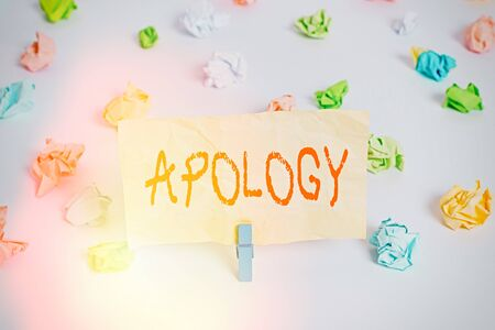 Text sign showing Apology. Business photo showcasing a written or spoken expression of one s is regret remorse or sorrow Colored crumpled papers empty reminder white floor background clothespin