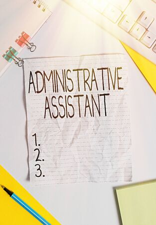 Writing note showing Administrative Assistant. Business concept for Administration Support Specialist Clerical Tasks Colored paper different sizes binder clip sheets white desk empty space