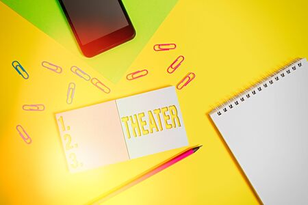 Writing note showing Theater. Business concept for building or outdoor area in which plays and dramatic performances Square blank sticky notepads pencil smartphone sheet color background