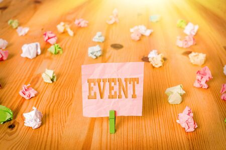 Text sign showing Event. Business photo showcasing Function to generate money for non profit a Crowded Occassion Colored crumpled papers empty reminder wooden floor background clothespin