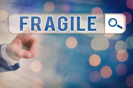 Writing note showing Fragile. Business concept for Breakable Handle with Care Wrap Glass Hazardous Goods