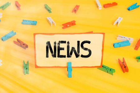Conceptual hand writing showing News. Concept meaning a spoken or written account of something that one has observed Colored clothespin papers empty reminder yellow floor office