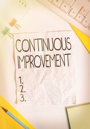 Writing note showing Continuous Improvement. Business concept for Ongoing Effort to Advance Never ending changes Colored paper different sizes binder clip sheets white desk empty space