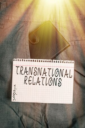 Conceptual hand writing showing Transnational Relations. Concept meaning International Global Politics Relationship Diplomacy Small wallet inside trouser front pocket near notation paper Banque d'images