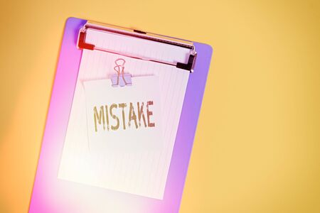 Word writing text Mistake. Business photo showcasing Something not correct Lack of accuracy Wrong Incorrect Fail Slim clipboard holding blank paper sheet note binder colored background