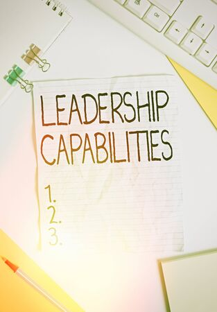 Writing note showing Leadership Capabilities. Business concept for Set of Performance Expectations a Leader Competency Colored paper different sizes binder clip sheets white desk empty space