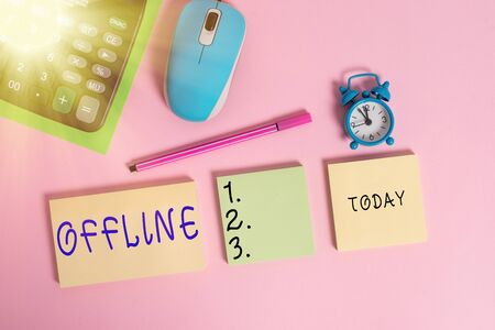 Text sign showing Offline. Business photo text Not having directly connected to a computer or external network Notepads mouse alarm clock calculator sheet marker colored background