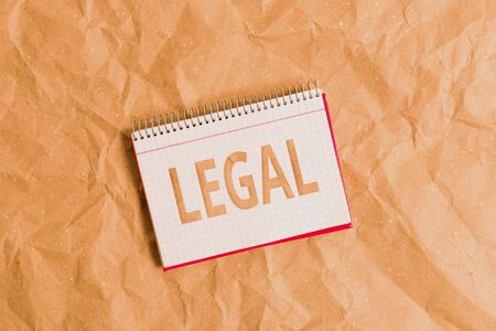 Conceptual hand writing showing Legal. Concept meaning Allowable or enforceable by being in conformity with the law Papercraft desk square spiral notebook office study supplies