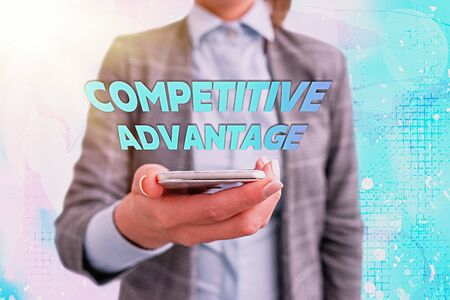 Conceptual hand writing showing Competitive Advantage. Concept meaning Company Edge over another Favorable Business Position 写真素材