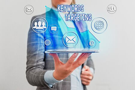 Writing note showing Keywords Targeting. Business concept for Use Relevant Words to get High Ranking in Search Engines