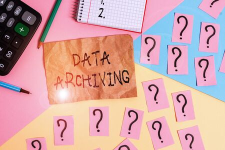 Word writing text Data Archiving. Business photo showcasing to secure and to store data for long term retention Mathematics stuff and writing equipment above pastel colours background Banque d'images